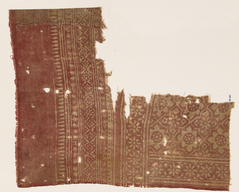 Textile fragment with rosettes set into linked stars (EA1990.331, front            )