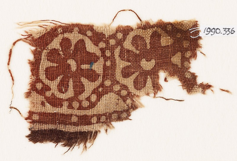 Textile fragment with two rosettes