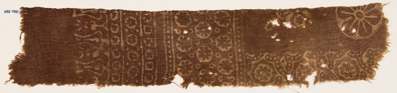 Textile fragment with small and large rosettes