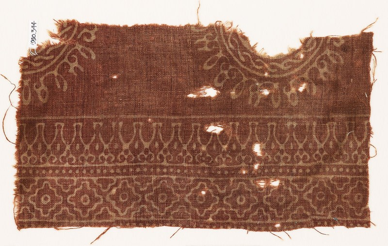 Textile fragment with parts of circles, stylized bodhi leaves, and diamond-shapes