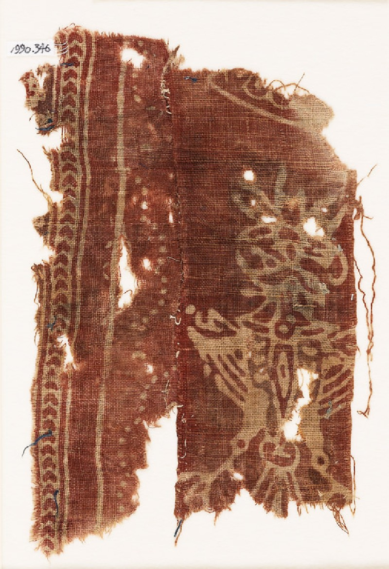 Textile fragment with large stylized form, possibly a double-headed eagle