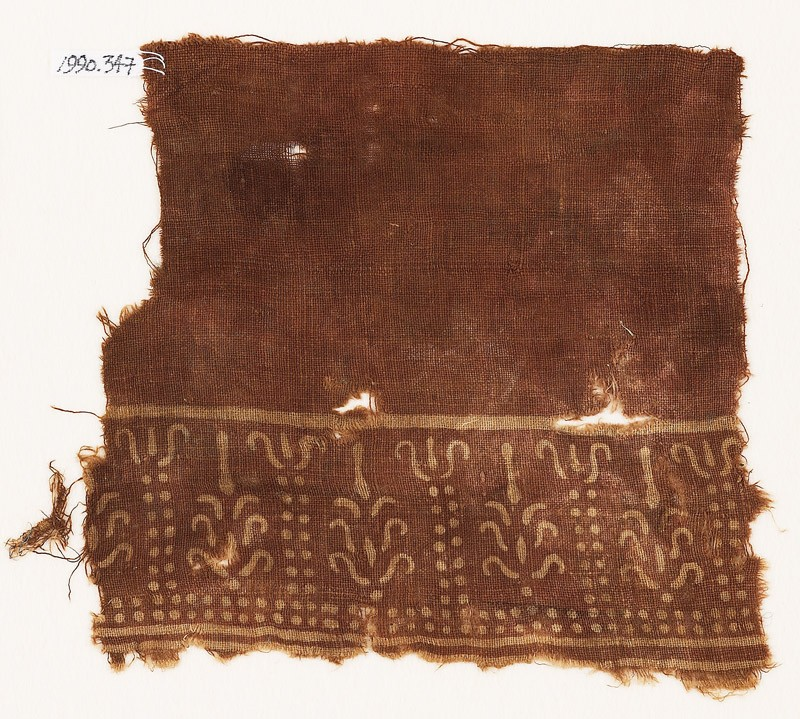 Textile fragment with dots and stylized trees