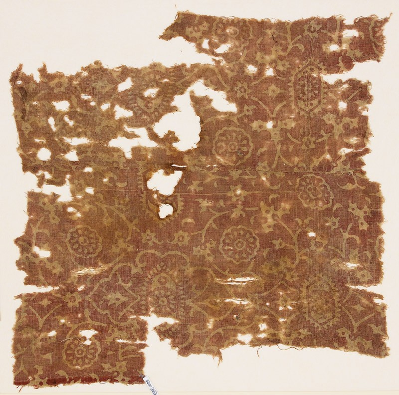 Textile fragment with tendrils and rosettes (front            )