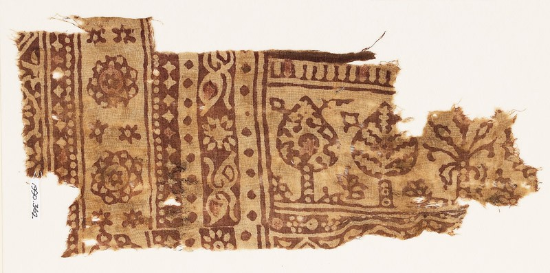 Textile fragment with stylized trees and three-layered rosettes (front            )