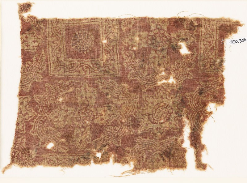 Textile fragment with ornate squares, flowers, and crosses