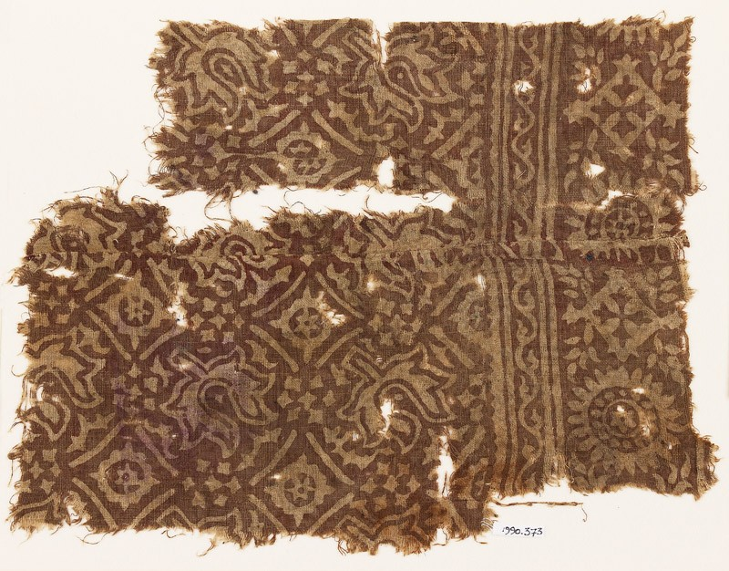 Textile fragment with flower-heads, stars, and squares (EA1990.373, front            )