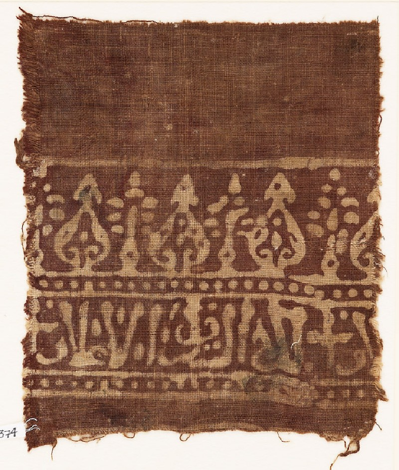 Textile fragment with stylized trees and script (EA1990.374, front            )