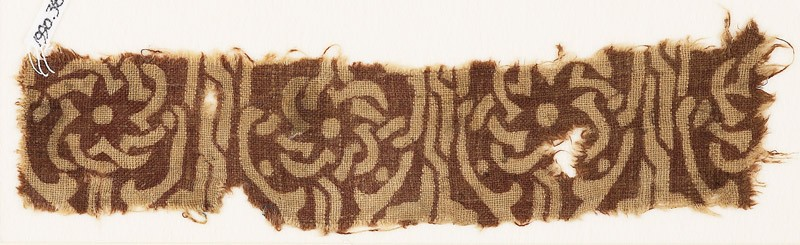 Textile fragment with interlace forming flower-shapes (EA1990.381, front            )