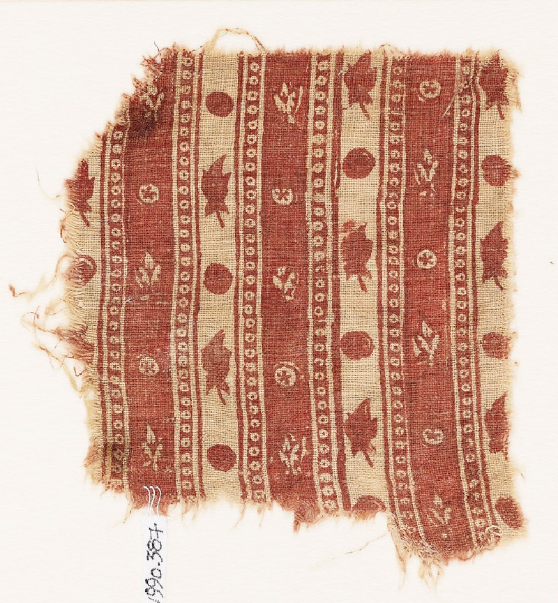 Textile fragment with bands of flowers and circles (front            )