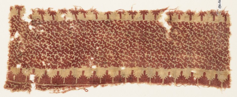 Textile fragment with stylized tendrils and crenellations