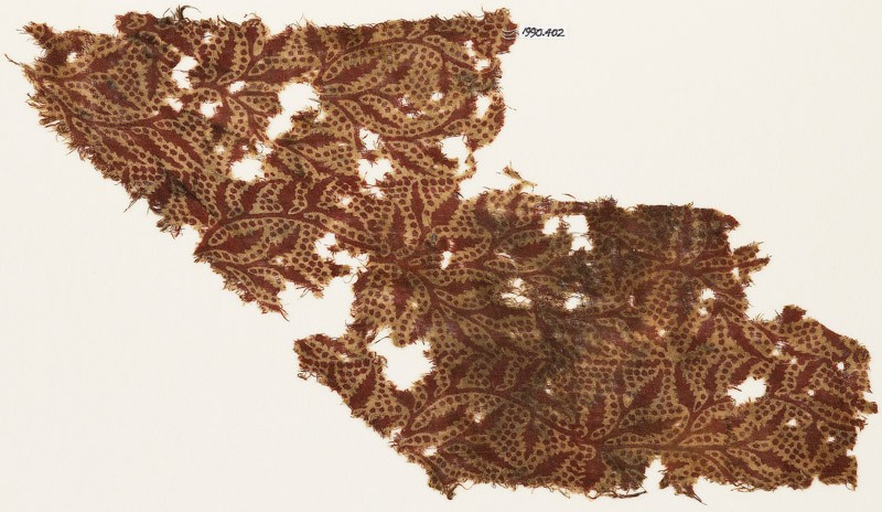 Textile fragment with tendrils and dots