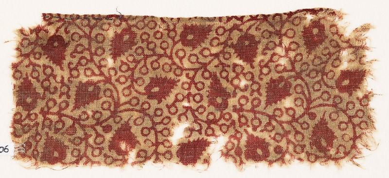 Textile fragment with linked tendrils and flower-heads