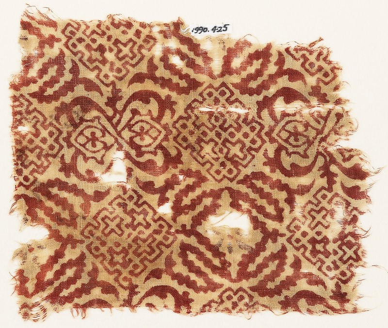 Textile fragment with squares, crosses, dots, and tendrils