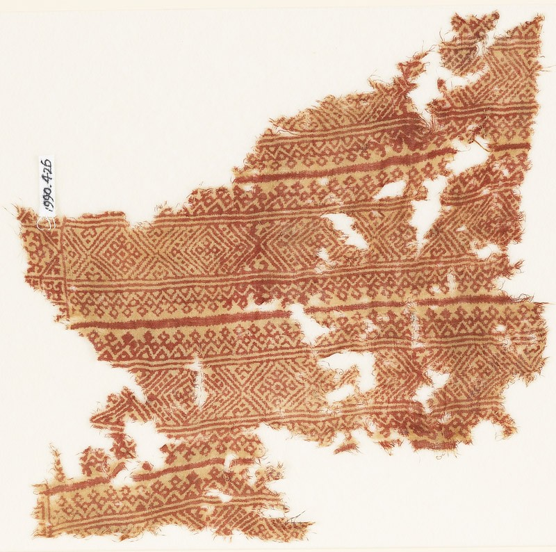 Textile fragment with bands of diamond-shapes and triangles