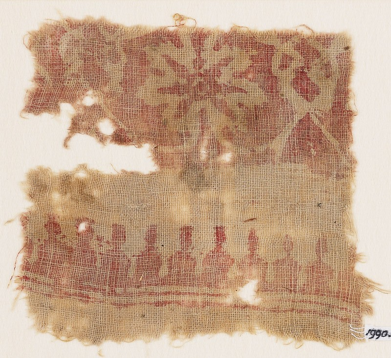 Textile fragment with flower and interlace (front            )