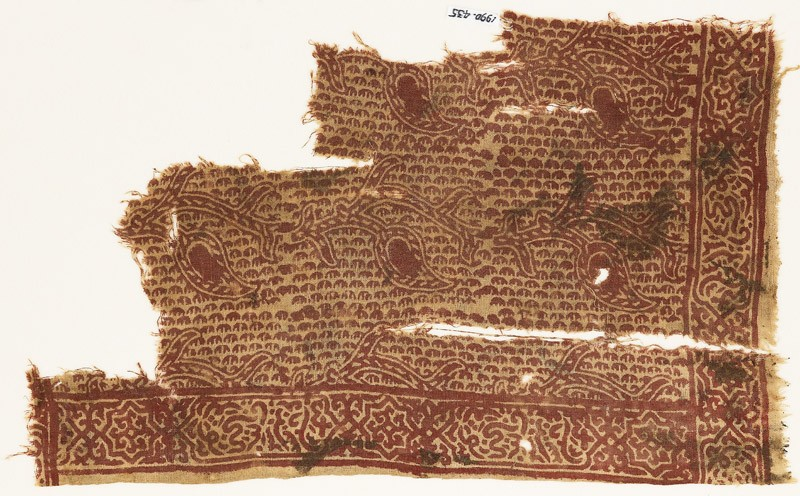 Textile fragment with stalk, leaves, and Persian-style script (front            )