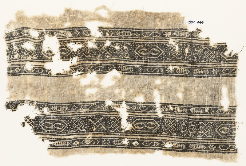 Textile fragment with bands of S-shapes, cartouches, stars, and interlace (EA1990.444, front            )