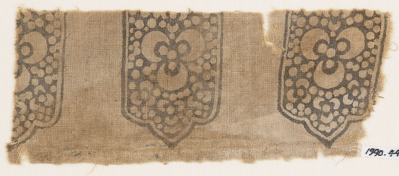 Textile fragment with tab-shapes, trefoils, and dots (EA1990.445, front            )