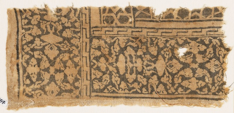 Textile fragment with floral patterns, leaves, and interlace (front            )