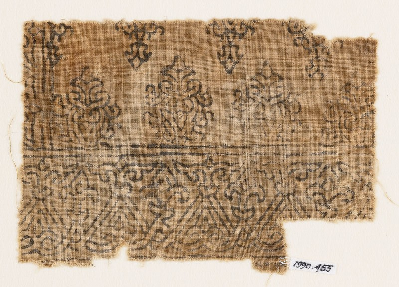 Textile fragment with tendrils forming interlace