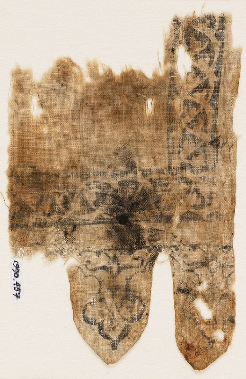 Textile fragment with interlace, and two tabs filled with tendrils
