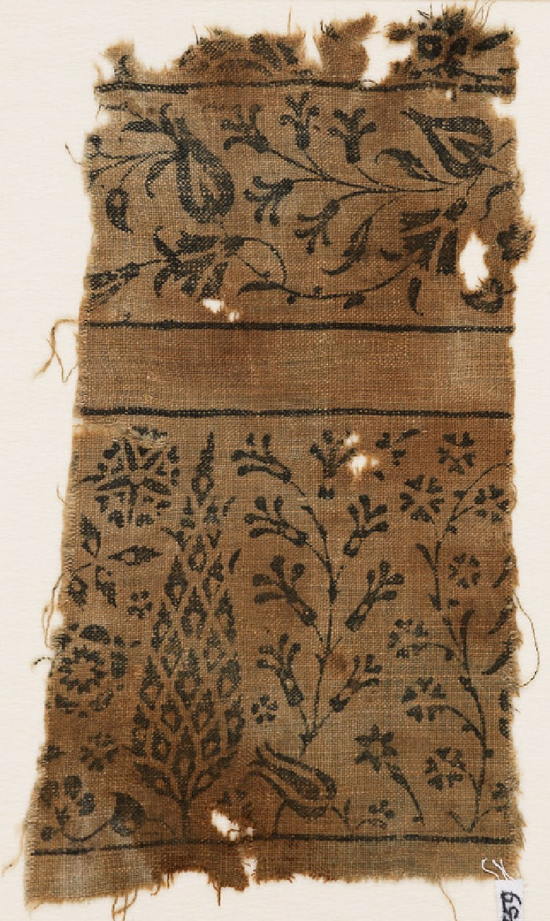 Textile fragment with stylized tree, flowering plants, vine, and flower-heads (EA1990.459, front            )