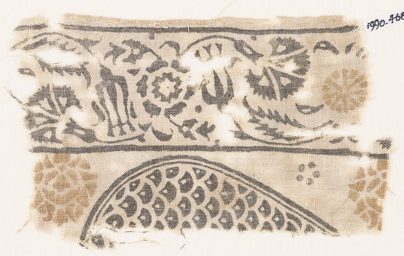 Textile fragment with carnations and tulips, and part of a tear-drop