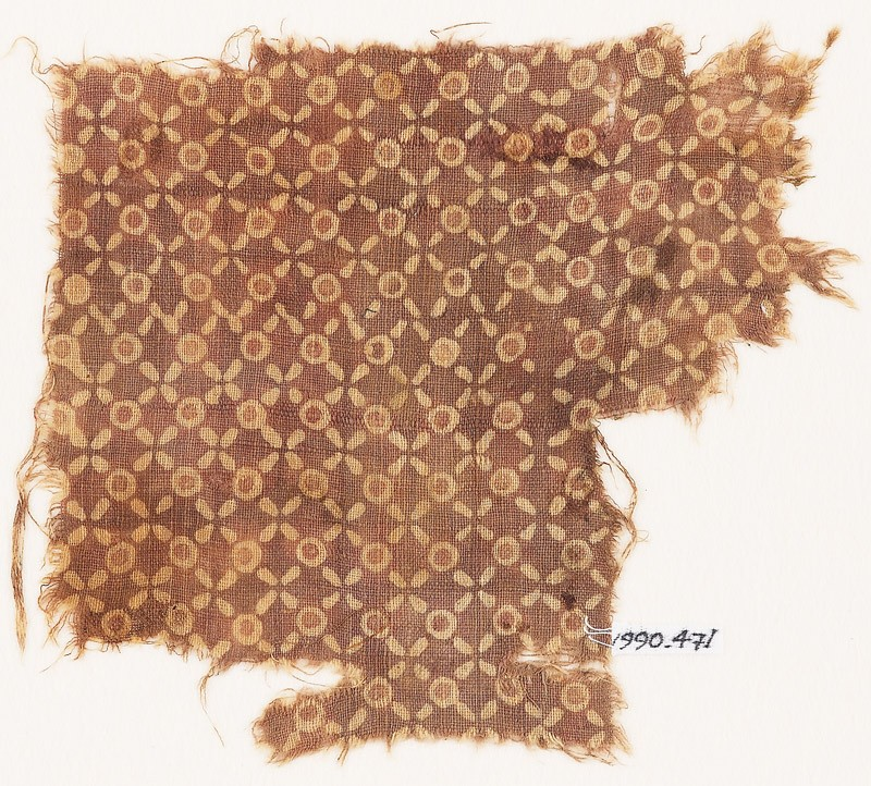 Textile fragment with quatrefoils and circles