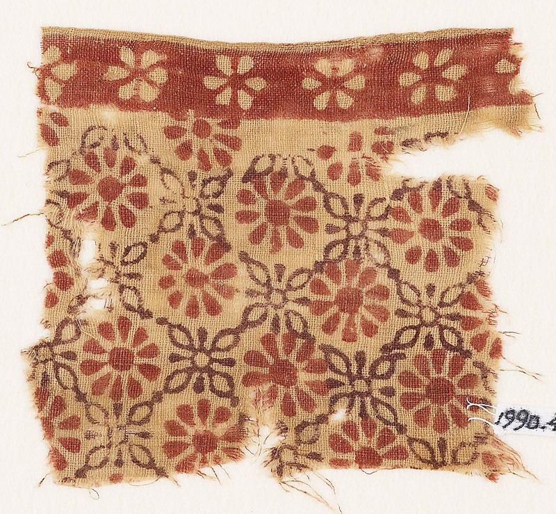 Textile fragment with rosettes and linked quatrefoils