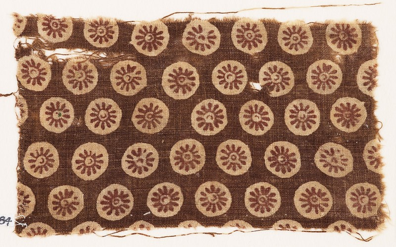 Textile fragment with rosettes in circles
