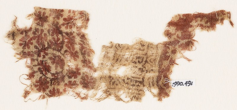 Textile fragment with rosettes, flower-heads, arches, and tendrils