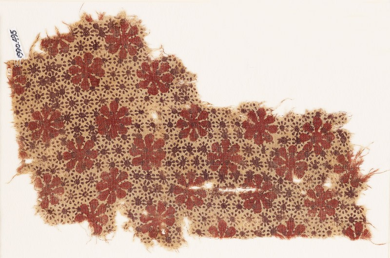 Textile fragment with large and very small rosettes (EA1990.495, front            )