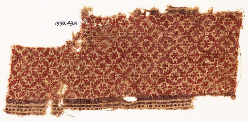 Textile fragment with interlocking quatrefoils