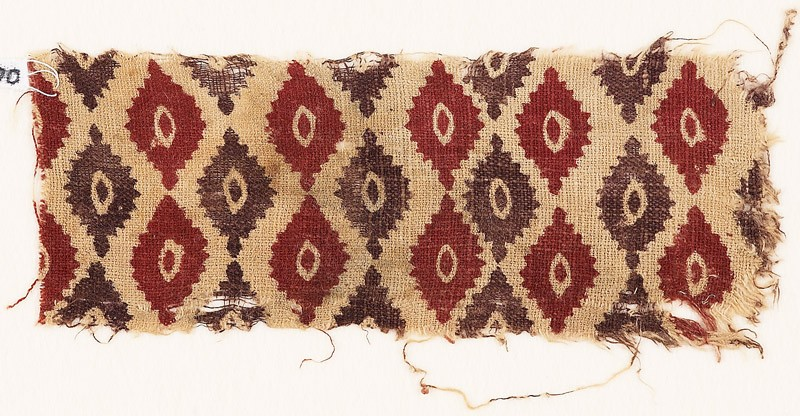Textile fragment with indented ovals