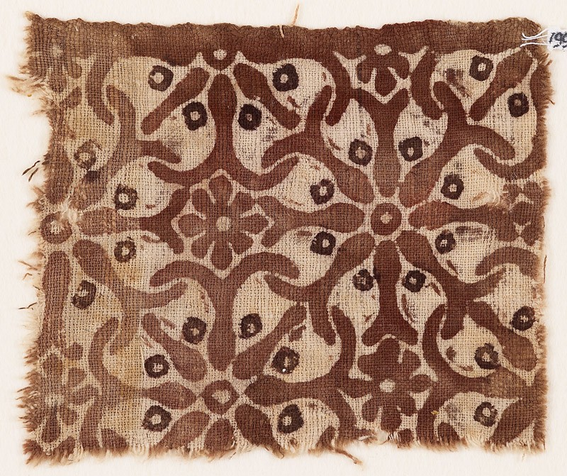Textile fragment with interlocking spirals or rosettes (EA1990.510, front            )