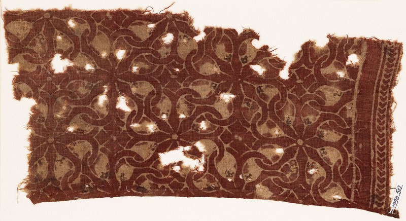 Textile fragment with interlocking spirals or rosettes