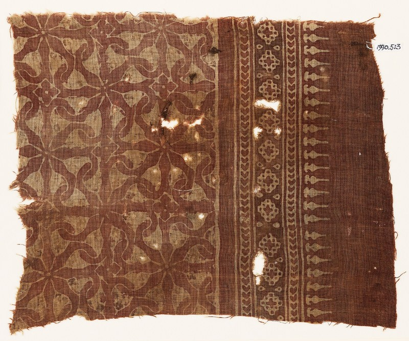 Textile fragment with interlocking spirals or rosettes (front            )