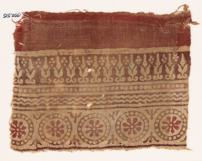 Textile fragment with rosettes in dotted circles, and abstract plants (front            )