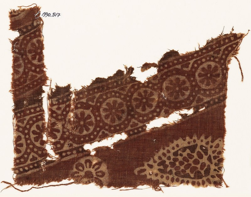 Textile fragment with rosettes in dotted frames, and a tear-drop (EA1990.517, front            )