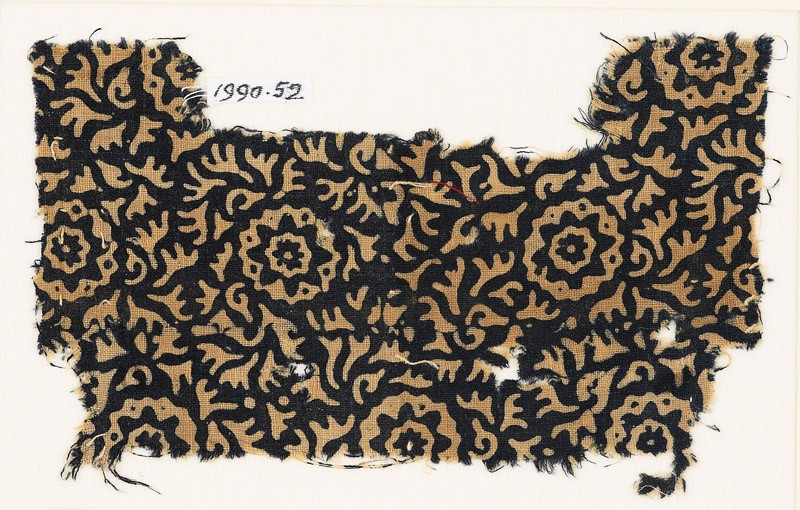 Textile fragment with swirling leaves and flowers