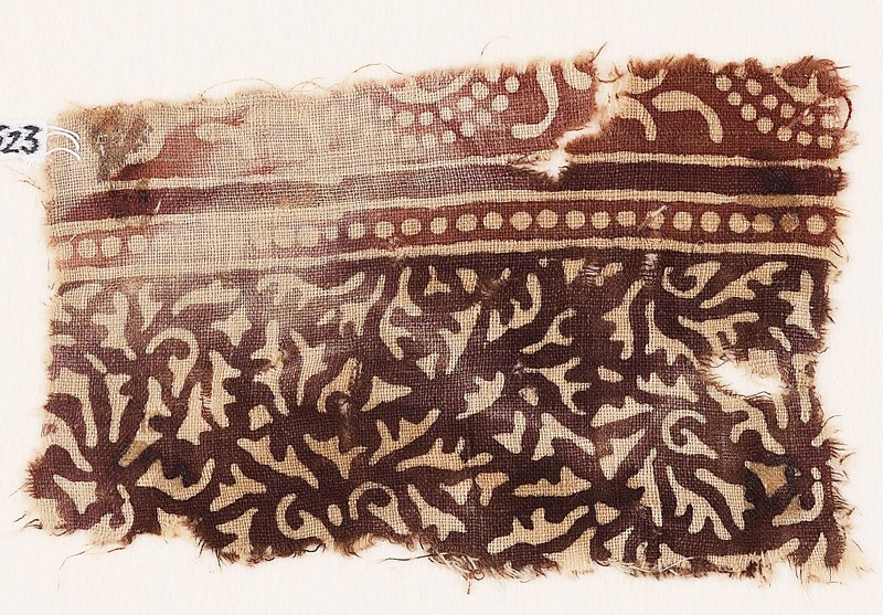 Textile fragment with swirling leaves and tendrils