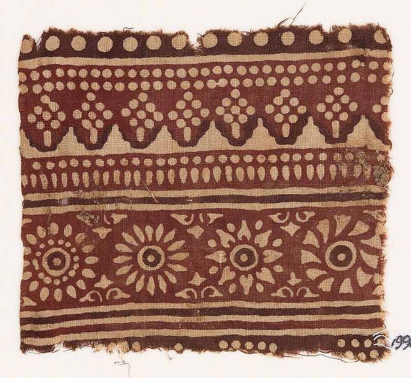 Textile fragment with rosettes and dots (front            )