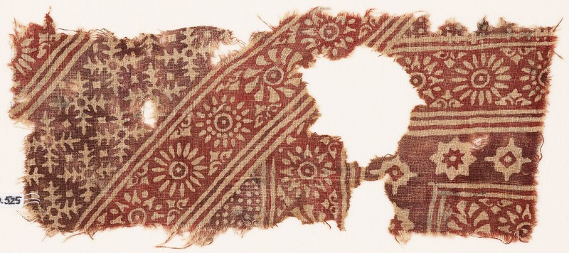 Textile fragment with rosettes, serrated crosses, stars, and dots (EA1990.525, front            )