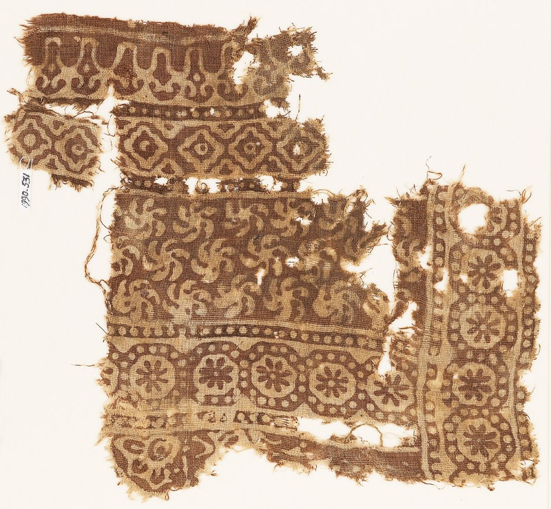 Textile fragment with bands of rosettes in dotted circles, spirals, and diamond-shapes (EA1990.531, front            )