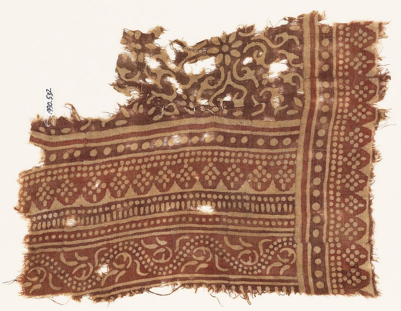 Textile fragment with bands of dotted patterns, vine, rosettes, and tendrils