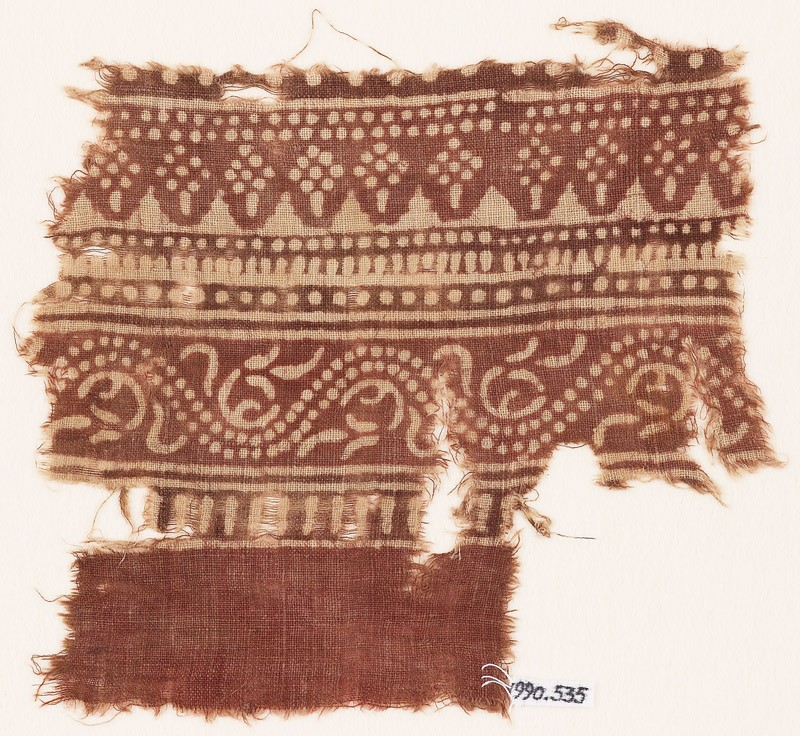 Textile fragment with bands of dotted patterns and vine (front            )