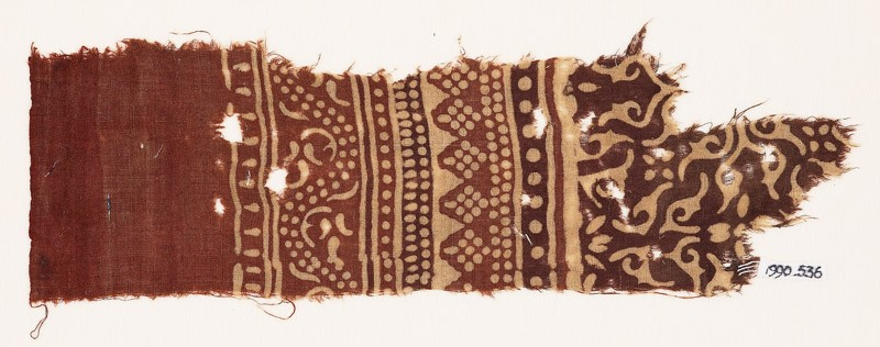 Textile fragment with bands of dotted patterns, vine, and stylized leaves (EA1990.536, front            )
