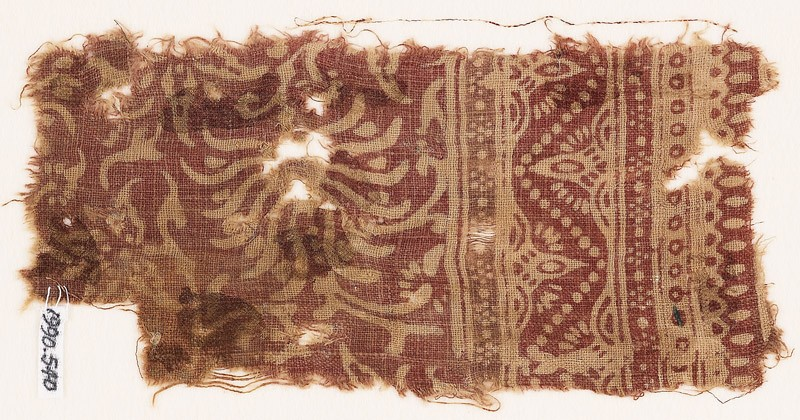 Textile fragment with swirling flower-heads and a dotted zigzag (EA1990.540, front            )