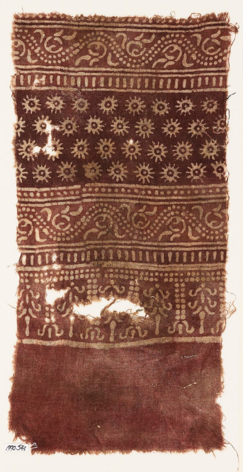 Textile fragment with bands of dotted vines, tendrils, rosettes, and stylized trees (EA1990.541, front            )