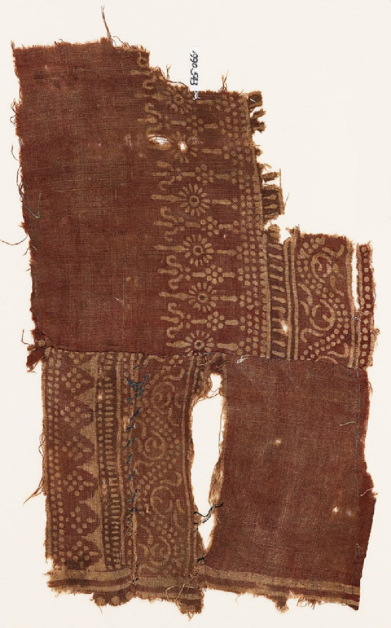 Textile fragment with dotted vines, possibly stylized columns, and poles with rosettes (EA1990.543, front            )
